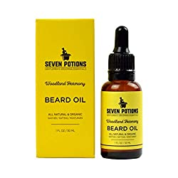 Beard Oil 1 fl oz by Seven Potions. Sweet and Woody Scented Beard Softener. Stops Beard Itch. Natural, Organic, Vegan, Beard Conditioning Oil. Contains Jojoba Oil (Woodland Harmony)  Image