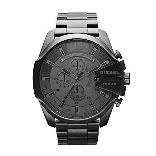 """51IsJOEpMiL Round watch featuring trio of subdials, """"Only the Brave"""" plaque under 12 o'clock, and logoed crown hardware 59 mm gunmetal-tone stainless steel case with mineral dial window Quartz movement with analog display"""