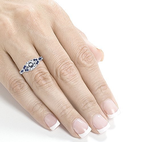51WQE11AK7L Center stone is a 1ct Round Cut Genuine Kobelli Moissanite Accent stones are Natural Conflict-Free Sapphire and Diamonds Satisfaction Guaranteed. Return or Exchange Policy Within 30 Days