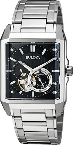 51nzyXgmK1L Distinctive rectangular watch featuring black dial with open aperture overlapped by chronograph and 24-hour display 49 mm rectangular case with synthetic sapphire dial window and exhibition back Automatic self-wind movement with analog display