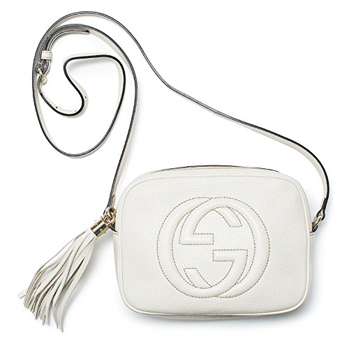 """51tw mfD3LL Gucci Soho Leather Disco Bag, Mystic White Leather. Light golden hardware. Embossed interlocking G.'s Adjustable leather strap to be worn across the body with 22"""" drop. Detachable leather tassel. Zip closure. Natural cotton linen lining. Interior phone and open pockets. 6""""H x 8""""W x 3""""D. Made in Italy. Made in Italy."""