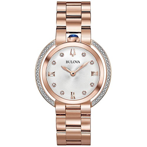 51yOQbE9ZVL From Bulova's Rubaiyat collection, this romantic timepiece is sure to add an elegant touch to your favorite ensembles Built in rose gold-tone stainless steel for durability, this watch features a textured silver-white dial that is hand-set with round diamond indices Additional round diamonds sparkle along the outer-rim of the case, setting the brilliance of this watch a step above the competition
