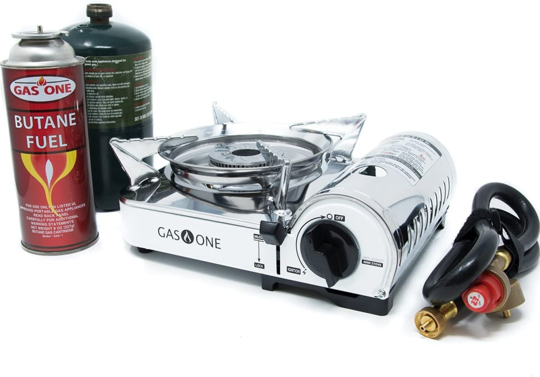 portable lightweight camping stoves with fuel tank by the left and hose by the rigth