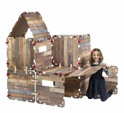 "Girl constructing with a ""Fantasy forts construction set"""