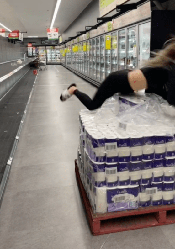 The TikTok user can be seen jumping on the pallet of new toilet paper packs.