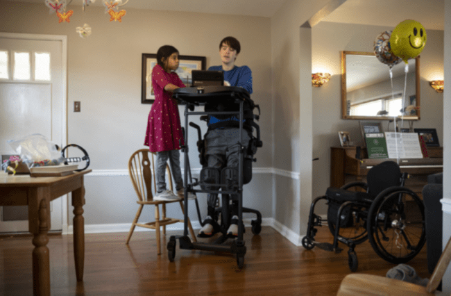 Mitchell Herndon plays on an iPad with his sister Miranda on his 19th birthday. Herndon was featured in an NBC News Digital documentary about what it was like to be one of only a handful of people in the world with a rare disease.