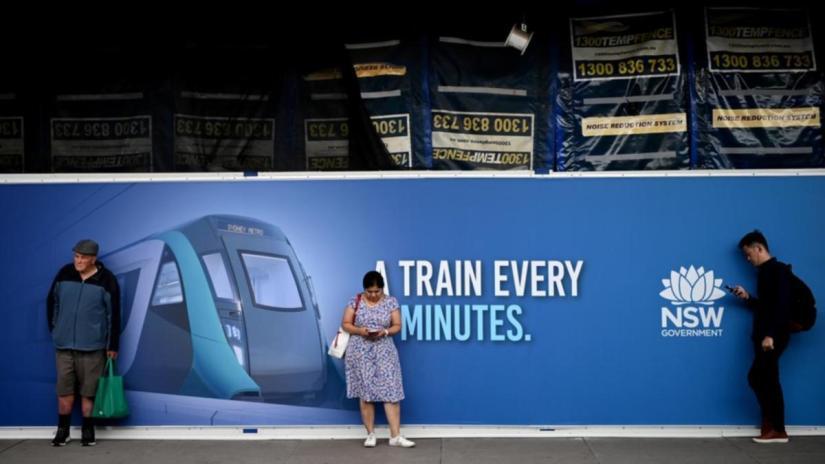 Rail passengers wait on a platform during peak times at Central Station
