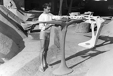 "Soleri with a model of his ""Beast Bridge"" design. Image © Cosanti Foundation"