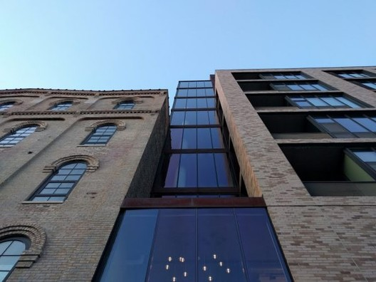 P Mill City Museum (left) with adjacent Humbolt Lofts in Minneapolis, image by Kurt Kohlstedt. Image via 99% Invisible
