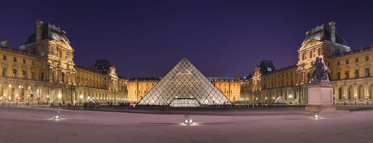 Louvre Pyramid at night by Benh LIEU SONG. Image via 99% Invisible