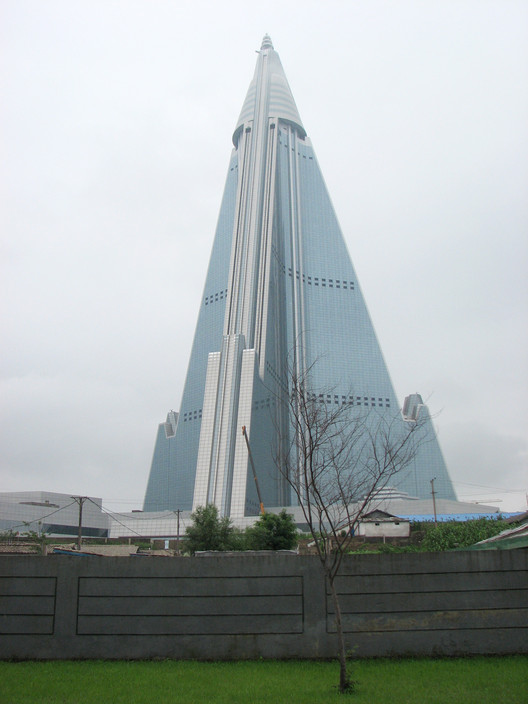 The Ryugyong Hotel. Started in 1987 and still only complete on the exterior, the hotel has been a empty shell looming over the city for years. Image © Alex Davidson
