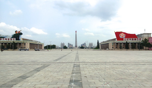 The view from Kim Il Sung Square, in front of the Grand People's Study House, looking towards the Juche Tower. Image © Alex Davidson