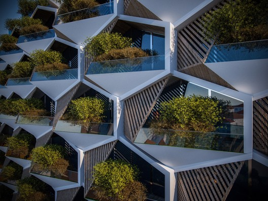 Modular hexagonal units with triangular gardens dominate the facade. Image Courtesy of Eray Carbajo