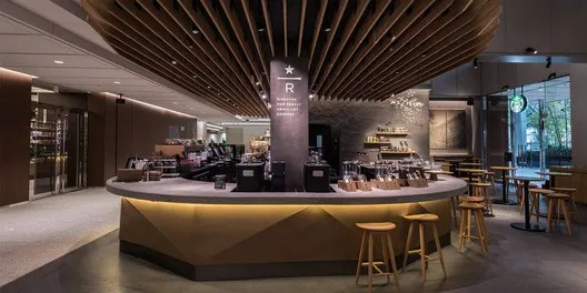 "The Ark Hills, Tokyo branch of Starbucks was remodeled in May 2016. It includes a horseshoe-shaped Experience Bar aimed to provide ""a 'third place' for individuals with refined tastes."". Image Courtesy of Starbucks Japan"