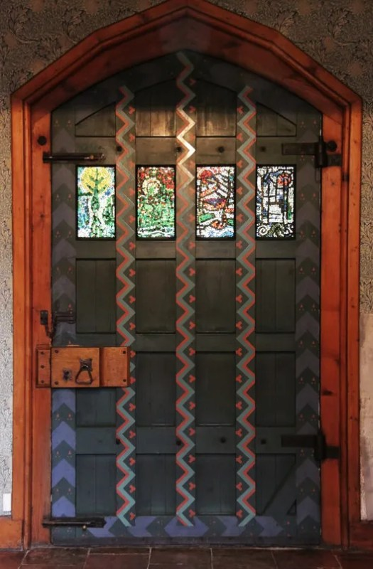 The painted front door is undeniably medieval in character; the stained glass window panes are not original. ImageCourtesy of Flickr user KotomiCreations (licensed under CC BY-NC 2.0)