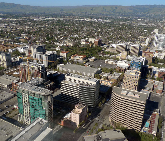 #5 San Jose. Median Price: $1,000,000, Median Income: $104,100, Median Multiple: 9.6. Image © <a href='https://commons.wikimedia.org/wiki/File:San_Jose_CA_Downtown_aerial_view_photo_D_Ramey_Logan.jpg'>Wikimedia user Don Ramey Logan</a> licensed under <a href='http://https://creativecommons.org/licenses/by/4.0/deed.en'>CC BY 4.0</a>
