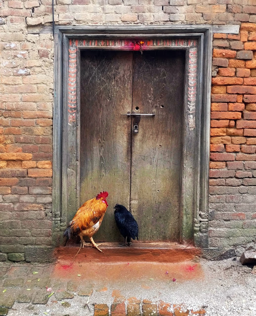"""There is a tradition of offering prayers at the door every morning. The two red dots are the offerings to the 'Dwarpals' (security guards)"". Image © Nipun Prabhakar"