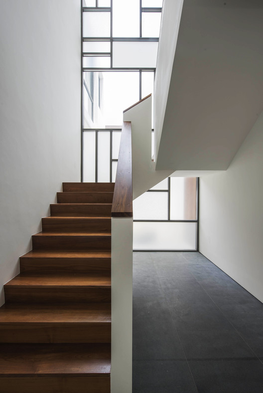Staircase. Image Courtesy of Ming Architects