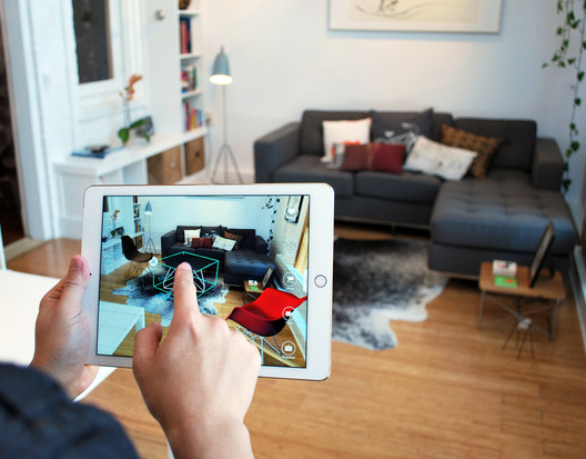 The app Pair allows architects to drag-and-drop 3-D models of consumer furnishings into their designs using iPhones or iPads. © Pair