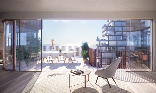 The easily openable façade allows for the living room to spill out onto the terrace during warmer weather. Image © 3XN