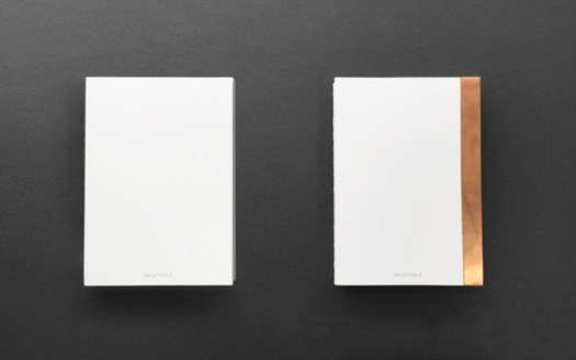 """Left: The """"pure-white"""" notebook without the copper accent; Right: the Notebook with a copper edge protector. Image via Kickstarter"""