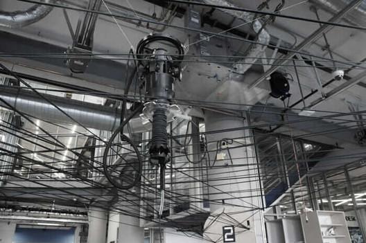 The carbon-fiber fabrication process centered around a fiber-weaving robot. Courtesy University of Stuttgart. Image Courtesy of University of Stuttgart