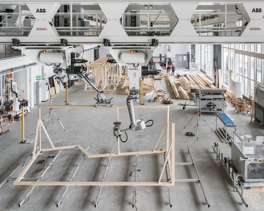 04_Robotic_Collaboration ETH Zurich Uses Robots To Construct Three-Story Timber-Framed House Architecture