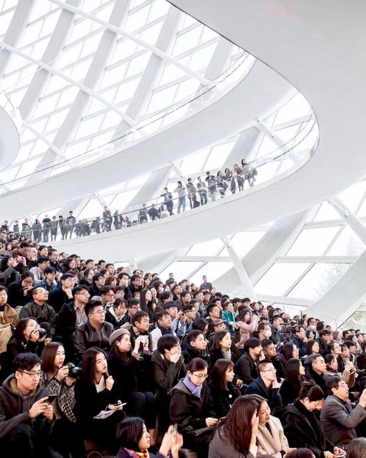 "Han Zhang at a keynote lecture by <a href=""https://www.archdaily.com/office/rcr-arquitectes"">RCR Aquitectes</a> in the <a href=""https://www.archdaily.com/165746/in-progress-phoenix-international-media-center-biad-ufo"">Phoenix Media Center</a> in Beijing. Image Courtesy of Han Zhang"