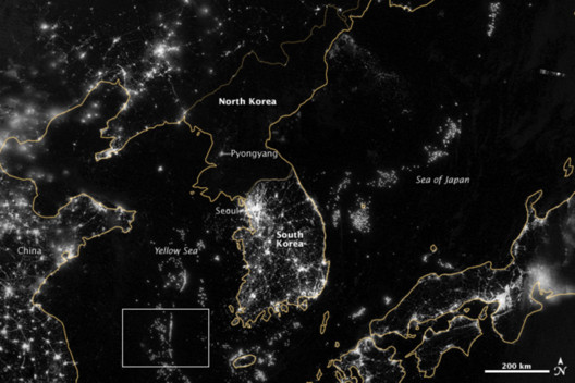 North and South Korea, 2012. White inset box shows light of fishing boats in Yellow Sea. NASA Earth Observatory image by Jesse Allen and Robert Simmon, using VIIRS Day-Night Band data from the Suomi National Polar-orbiting Partnership. Earth Science and Remote Sensing Unit, NASA Johnson Space Center