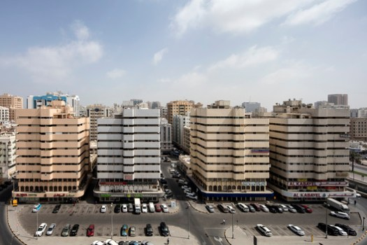 Northwest view of Bank Street buildings, Bank Street, Sharjah, Architects Tecnica y Proyectos (TYPSA), 1977. Image © Ieva Saudargaitė
