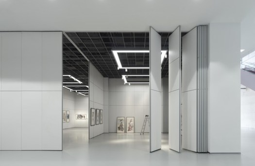 Exhibition area with mobile wall elements. Image © Christian Gahl