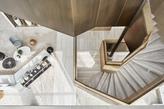 Overlooking the polygonal spiral staircase and lounge area. Image © Jianghe Zeng