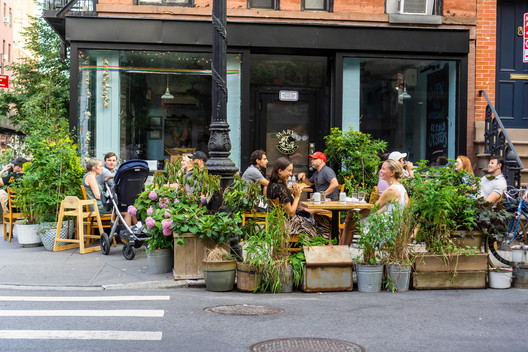 New York NY/USA-July 2, 2020 Outdoor dining at a restaurant in the Greenwich Village neighborhood in New York. Image via Shutterstock/ By rblfmr