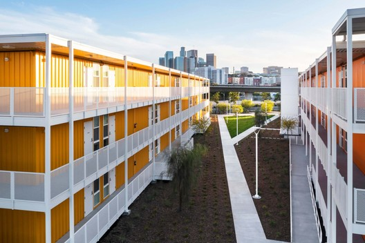 It might be hard to tell at first that the permanent housing units were built from former shipping containers. Image © Paul Vu