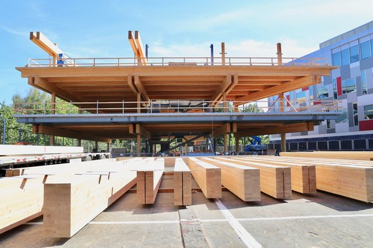 Adidas North American Headquarters Expansion in Portland, OR. South Building under construction showing the timber and steel system. Image Courtesy of LEVER Architecture