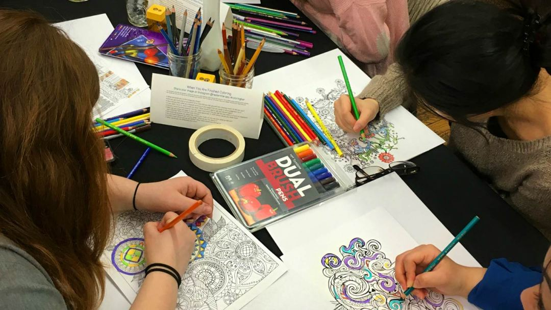 The Real Art Therapists of New York Coloring Book, and a group coloring bar.