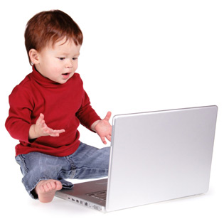 toddler on laptop