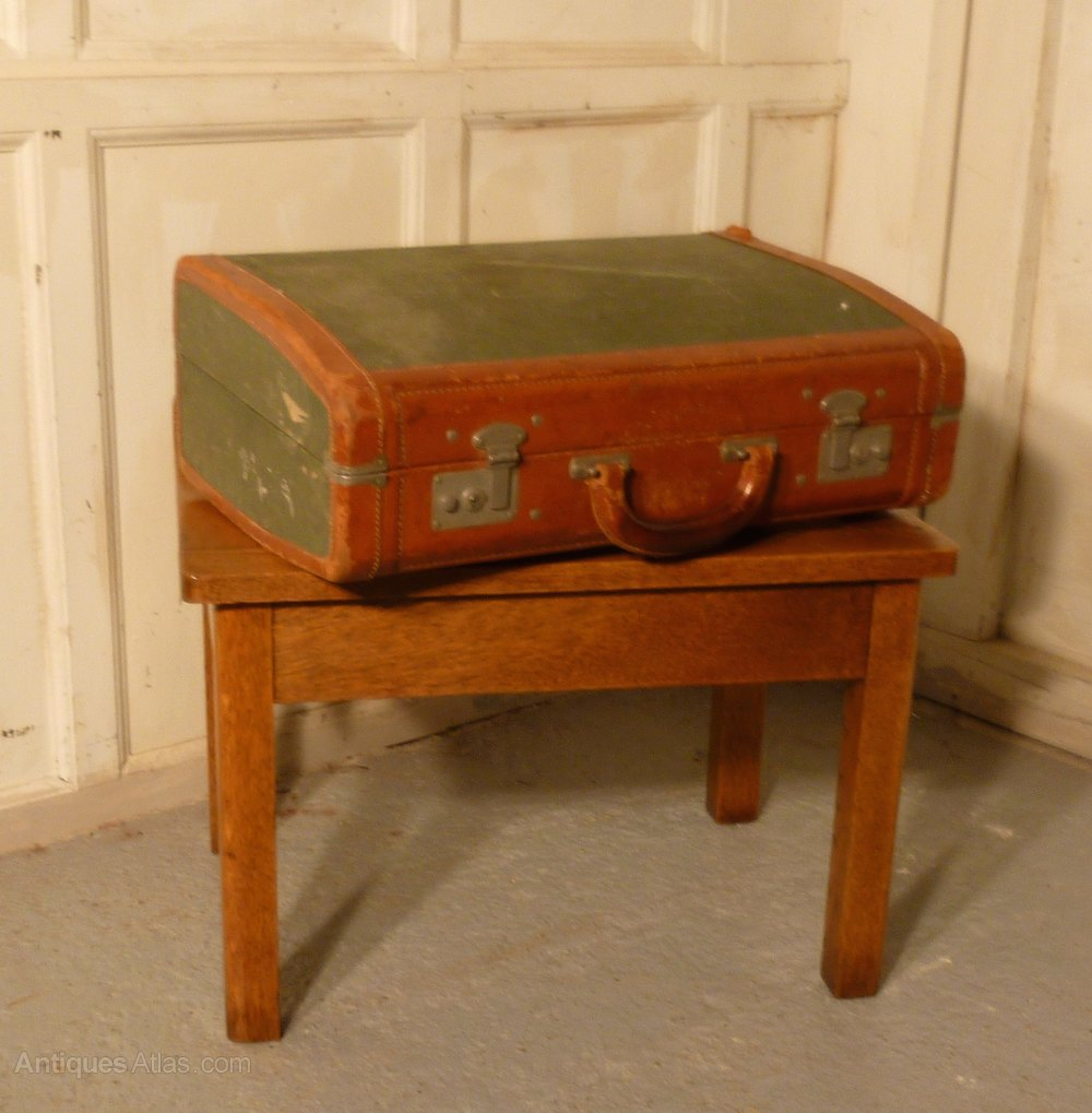 a sturdy pine luggage rack suitcase