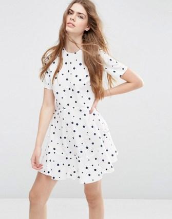 Image 1 ofASOS Short Sleeve Ruffle Hem Dress in Spot Print