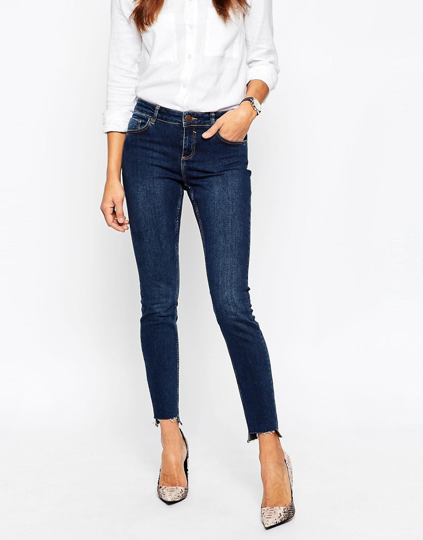 Image 1 ofASOS Lisbon Midrise Ankle Grazer Jeans in Binx Wash With High-Low Raw Hem
