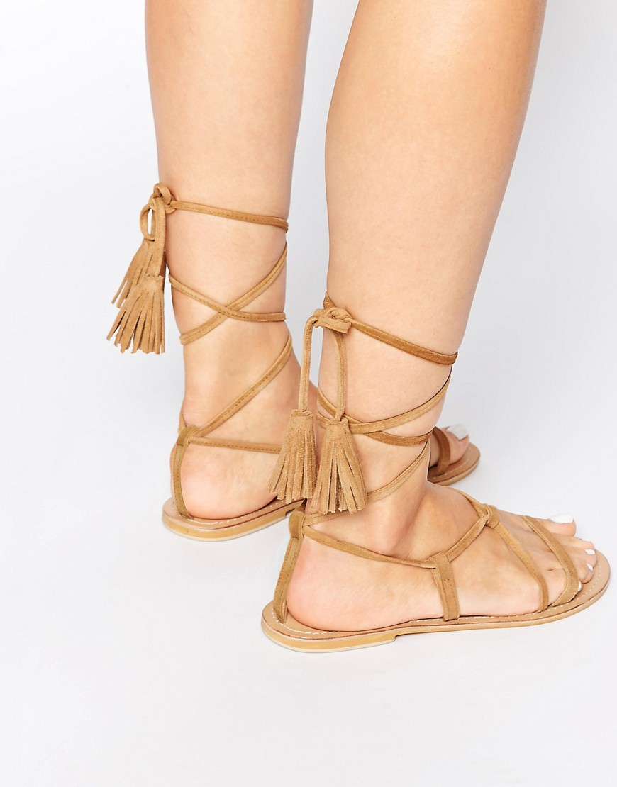 Image 1 ofASOS FLO Suede Tie Leg Sandals