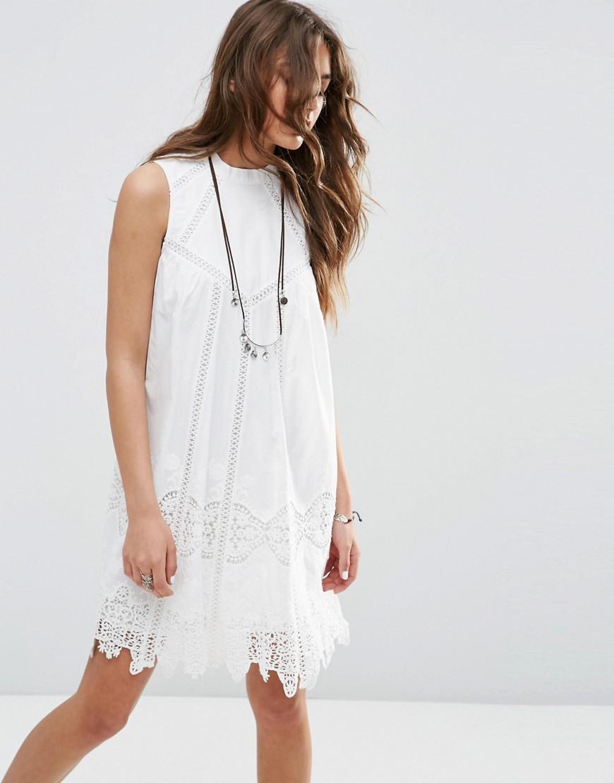 Bild 1 von ASOS Premium – Hochgeschlossenes, ausgestelltes Sommerkleid mit Spitze und Lochmuster