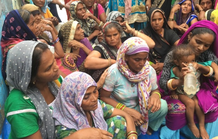 Women outside Sanjay's uncle's house on Wednesday