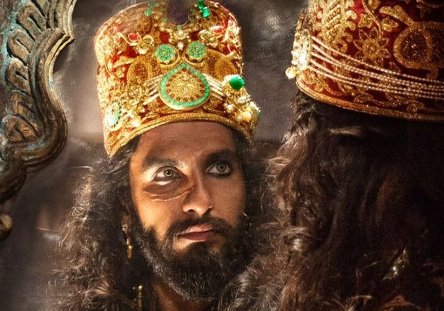 "Ranveer Singh as Khilji in <i data-recalc-dims=1></noscript>Padmaavat</i>."" data-reactid=""348″><figcaption class=merriweather-bold data-reactid=349>Ranveer Singh as Khilji in <i>Padmaavat</i>.</figcaption><figcaption class="