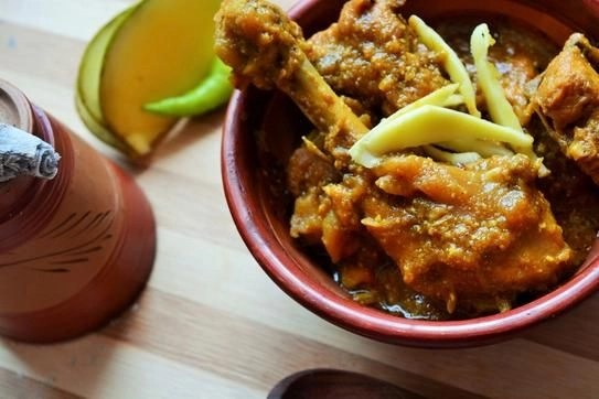 Chicken curry with raw mangoes.