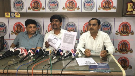 Alpesh Thakor waves proof during the press conference held on Sunday claiming that viral messages inciting mobs were spread by the BJP