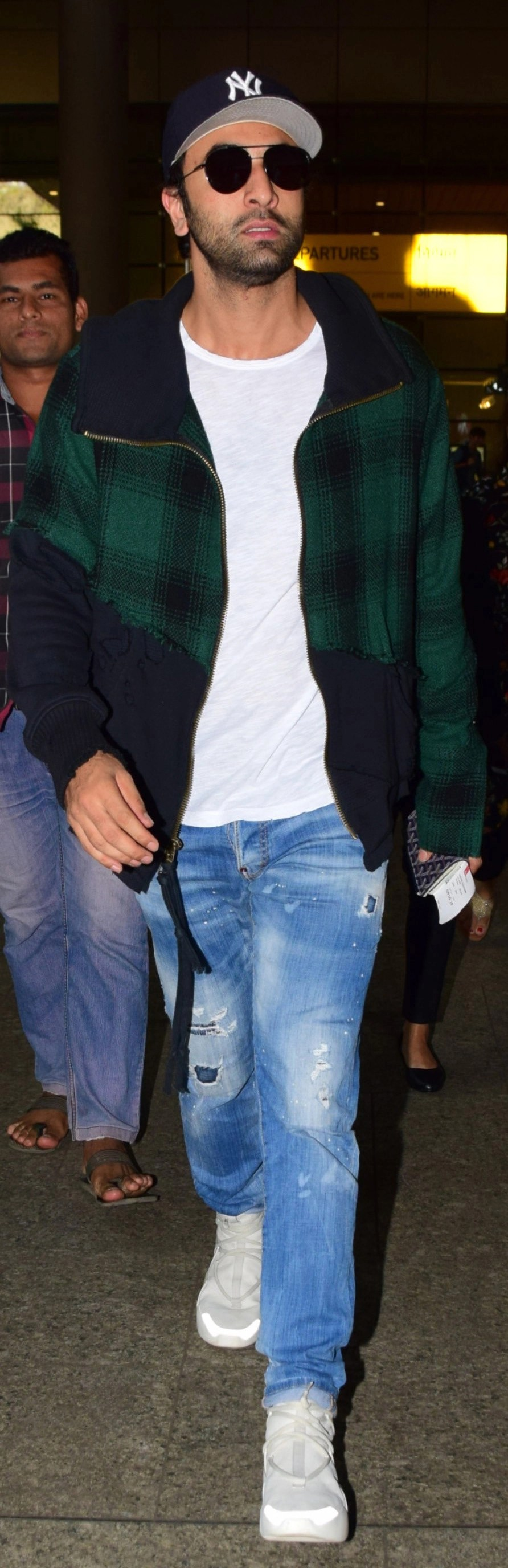 Ranbir went for a hip sporty athleisure look with oversized jacket, trainers and baseball cap.