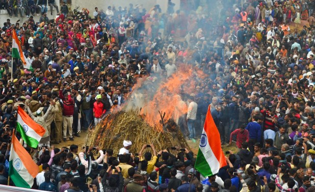 People gather during the cremation ceremony of slain CRPF jawan Kaushal Kumar Rawat , in Agra on 16 February 2019.