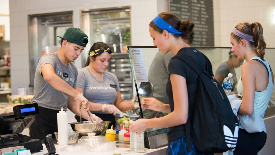 Customers ordering salads at Sweetgreen
