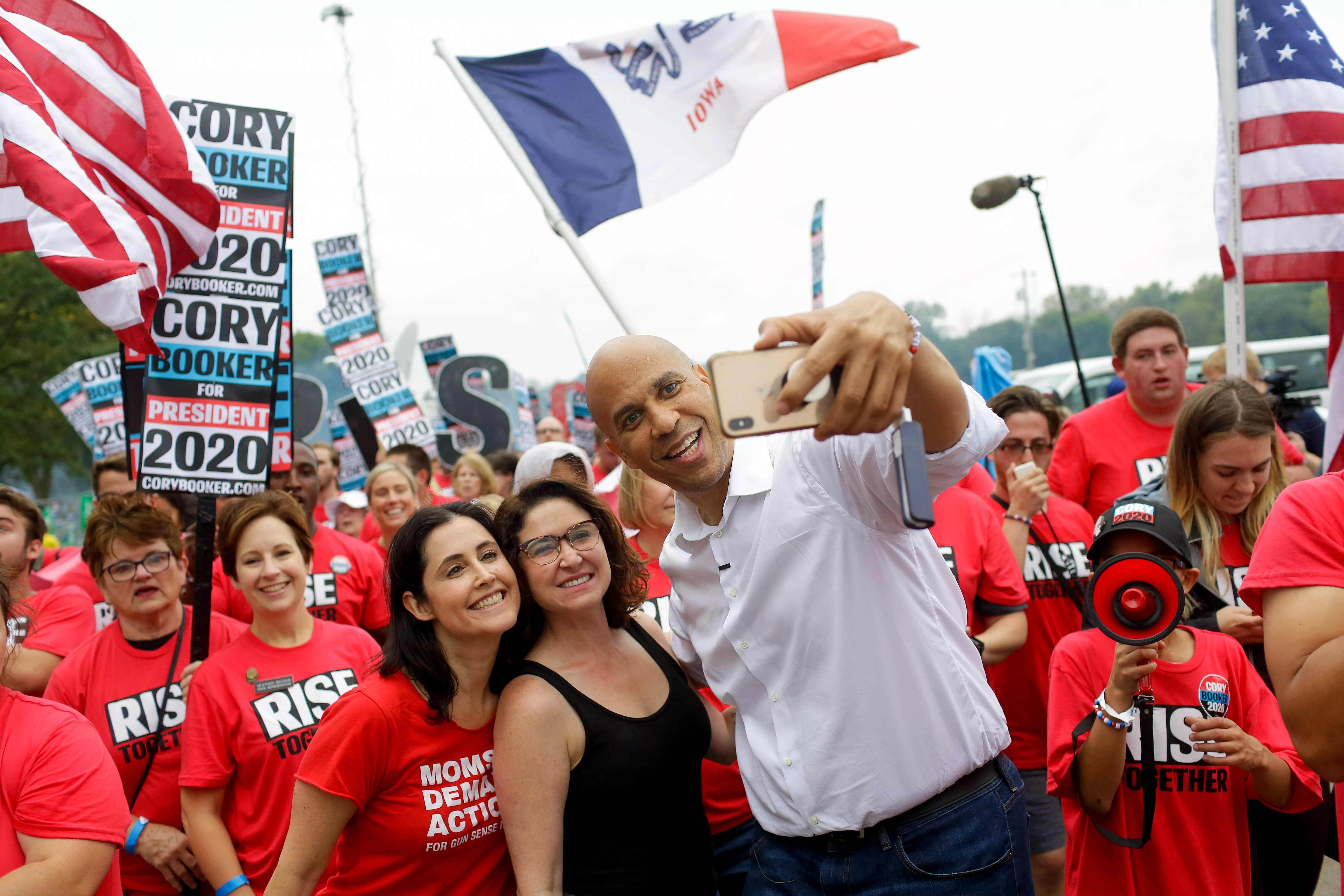 Democratic presidential candidate, Sen. Cory Booker (D-NJ) takes a selfie during the Democratic Polk County Steak Fry on September 21, 2019 in Des Moines, Iowa.